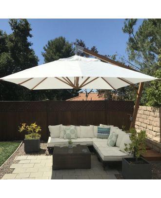wooden cantilever parasol over a patio table in a garden