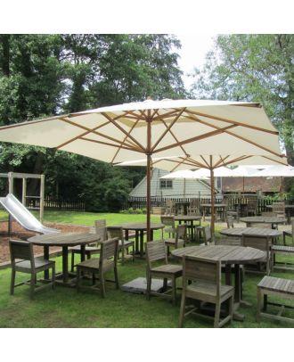 2 large square parasols shading a pub terrace